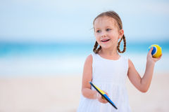 Little girl playing beach tennis Stock Photos