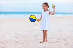 Little girl playing beach tennis Royalty Free Stock Photos