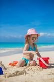 Little girl playing with beach toys during Stock Photography