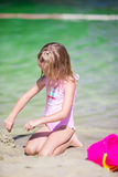 Little girl playing with beach toys during. Little cute girl playing with beach toys during tropical vacation Royalty Free Stock Photo