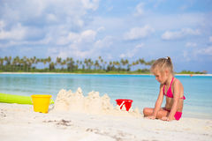 Little girl playing with beach toys on summer Stock Photos