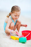 Little girl playing at beach Stock Photos