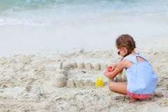 Little girl playing at beach Stock Images