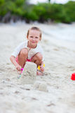 Little girl playing at beach Stock Photo