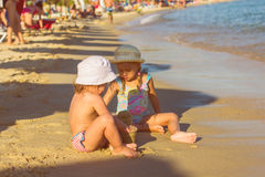 Little Girl Playing On The Beach. Two Little Girl, Playing on the beach, at the Aegean Sea Stock Image