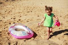 Little girl playing on beach royalty free stock photo