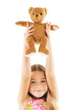 Little girl playing with bear toy Royalty Free Stock Image