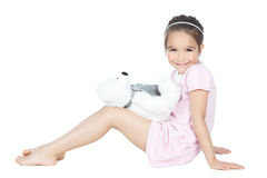 Little girl playing with bear toy Royalty Free Stock Images