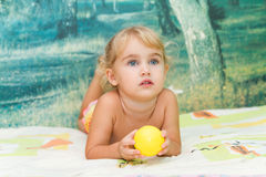 Little girl playing on the bed Royalty Free Stock Photo