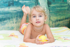 Little girl playing on the bed Stock Photo