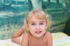 Little girl playing on the bed Stock Image