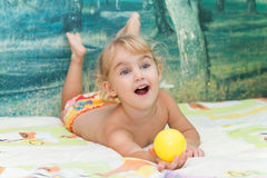Little girl playing on the bed Royalty Free Stock Image
