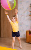 Little girl playing with a big ball Royalty Free Stock Images