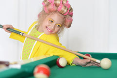 little girl playing billiard Royalty Free Stock Photos