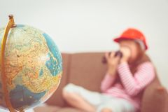 Girl playing with binocular and map Globe for travel conc royalty free stock images