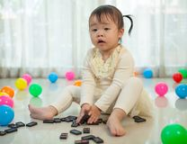 Little girl playing with black domino Royalty Free Stock Image