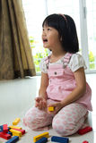 Little girl playing with blocks. Little Asian girl is playing with blocks toy Royalty Free Stock Photos
