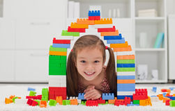 Little girl playing with blocks royalty free stock photo