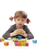 Little girl playing with blocks Stock Image