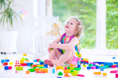 Little girl playing with blocks Stock Images