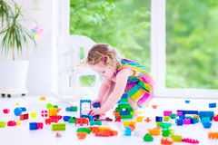 Little girl playing with blocks Stock Photography