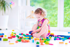 Little girl playing with blocks Royalty Free Stock Images