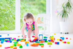 Little girl playing with blocks Royalty Free Stock Image