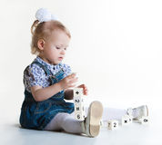 Little girl playing with blocks. On white background Stock Photography