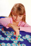 Little girl playing the board game Royalty Free Stock Photography