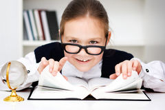 Little girl is playing with book Royalty Free Stock Photography