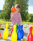 Little girl playing bowling Stock Image