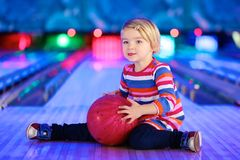Little girl playing bowling stock photography