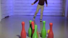 Little girl playing bowling stock footage