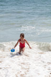 Little Girl Playing with a Bucket on the Beach Royalty Free Stock Photography