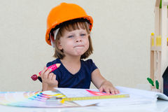 Little girl playing builder Stock Image