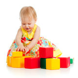 Little girl playing with building blocks Stock Image