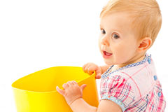 Little girl playing with building blocks. Cute blond baby girl playing  on a white blanket with some buliding blocks Stock Photos