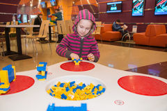 Little girl playing building blocks Stock Photography