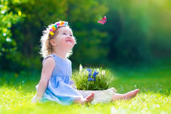 Little girl playing with a butterfly Royalty Free Stock Photos