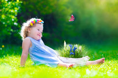 Little girl playing with a butterfly Royalty Free Stock Images