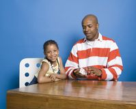 Little girl playing cards with Dad Stock Photos