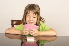 Little girl playing cards Royalty Free Stock Photo