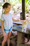 Little girl playing with cat. Outdoors royalty free stock image
