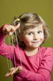 Little girl playing cats cradle game Royalty Free Stock Photo