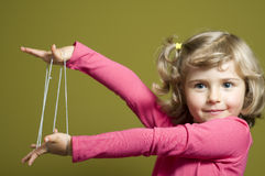 Little girl playing cats cradle game Stock Photo
