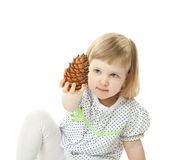 Little girl playing with cedar cone Royalty Free Stock Image