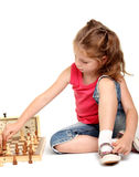 Little girl playing chess Stock Photography