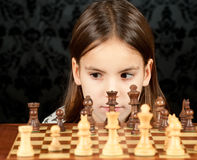 Little girl playing chess Stock Photos