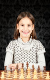 Little girl playing chess Royalty Free Stock Image