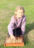 Little girl playing chess Stock Image